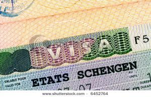stock-photo-schengen-visa-in-passport-closeup-6452764