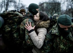 717512-a-new-volunteer-for-the-ukrainian-interior-ministry-s-azov-battalion-embraces-his-girlfriend-before-