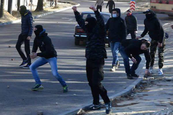 anti-gay_protesters_in_Ukraine_throwing_stones_insert_courtesy_of_Olena_Shevchenko_of_Insight