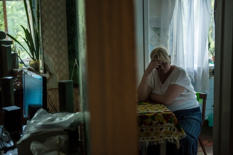 Maryna Anatoliivna Mikhnovska, whose son Yevgen Mykolayovych Myronov went missing from his apartment after being taken by soldiers, poses for a portrait in his apartment on Monday, July 11, 2016 in Kramatorsk, Ukraine.